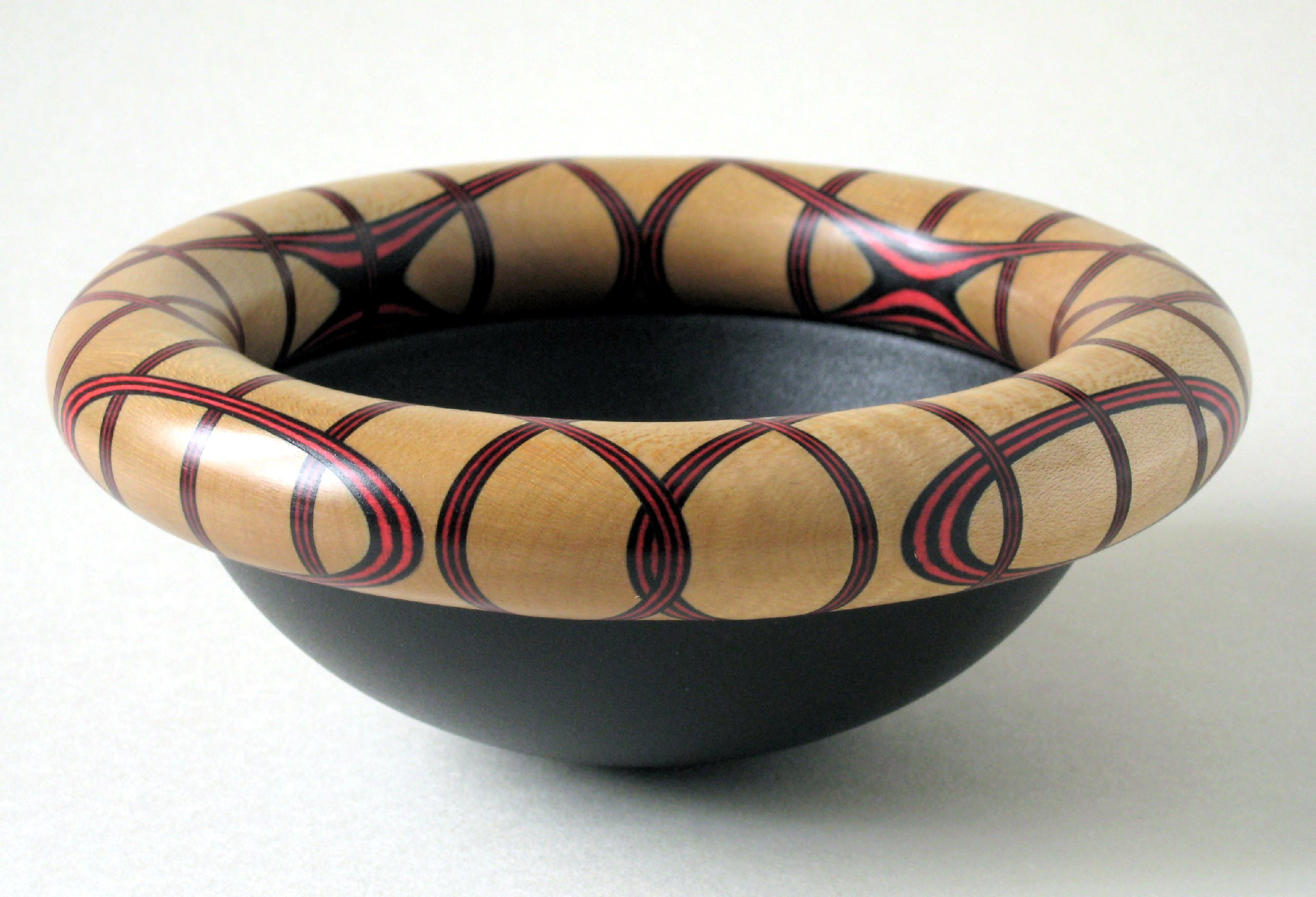 Red & Black small wobbly bottom bowl.  Red & Black laminated ringed bowl with ebonised bottom. 13cm x 6cm.